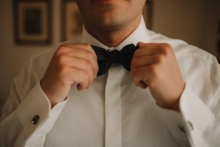 Groom preparations at destination wedding