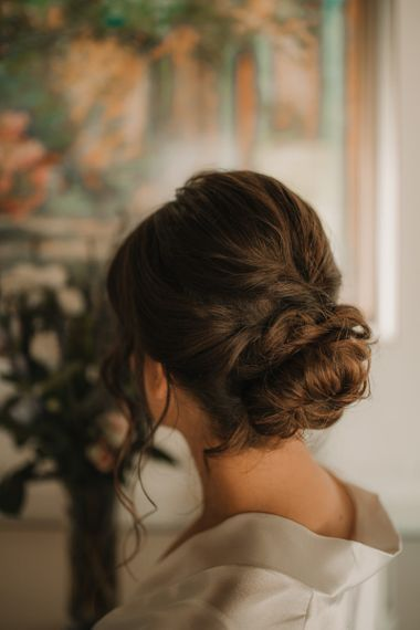 Pinned low updo for bride at Italy wedding