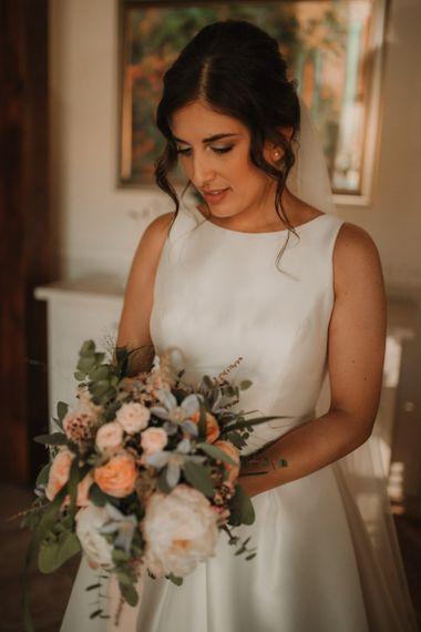 Rosa Clara wedding dress with blush bouquet for bride