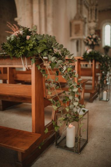Wedding ceremony decor with foliage and lanterns