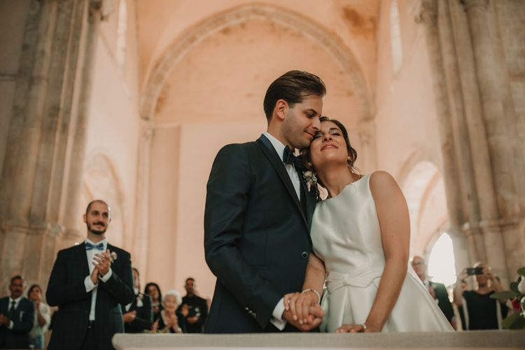 Bride and groom at church ceremony in Italy