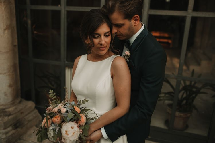 Bride in Rosa Clara dress with groom in tuxedo