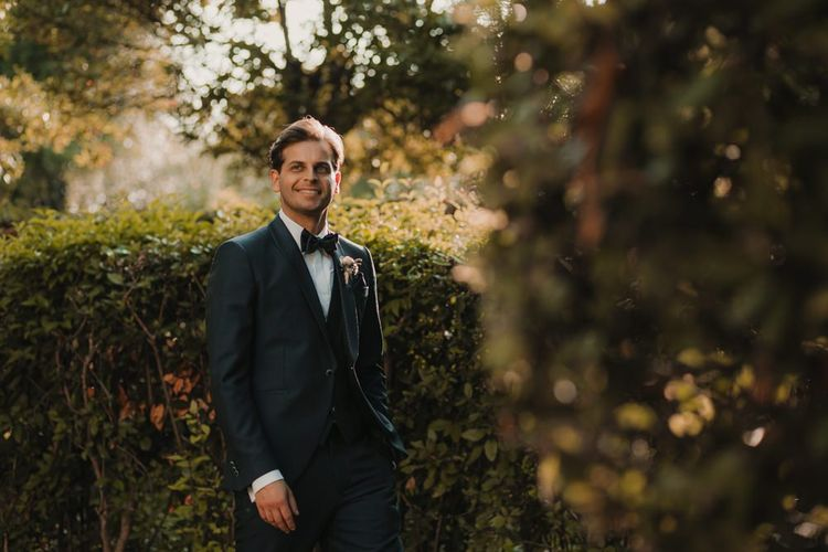 Groom in black tuxedo for wedding