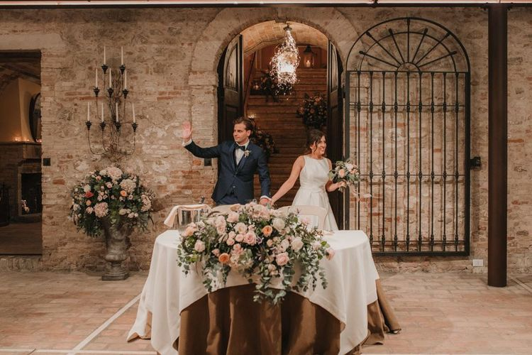 Bride in Rosa Clara dress with groom make their entrance