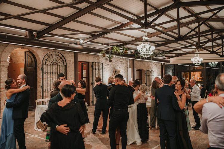 Guests enjoy dancing at Italian wedding