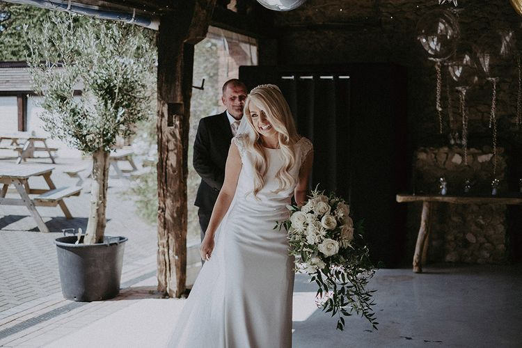 Bride in St Patrick Wedding Dress Holding White and Green Wedding Bouquet