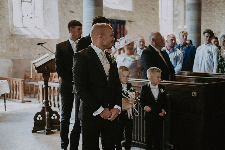 Groom Waiting at the Altar as His Bride Enters the Church Wedding Ceremony