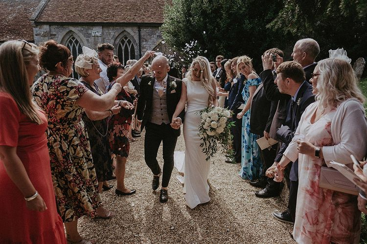 Confetti Moment with Bride in St Patrick Wedding Dress and Groom in Dark Suit