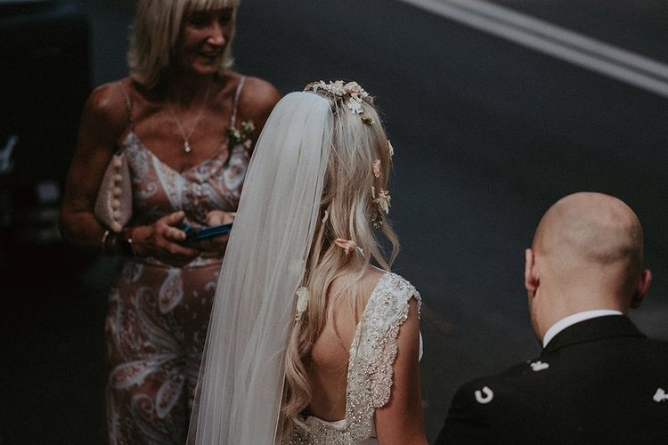 Bride Covered in Confetti Wearing Beaded Back St Patrick Wedding Dress