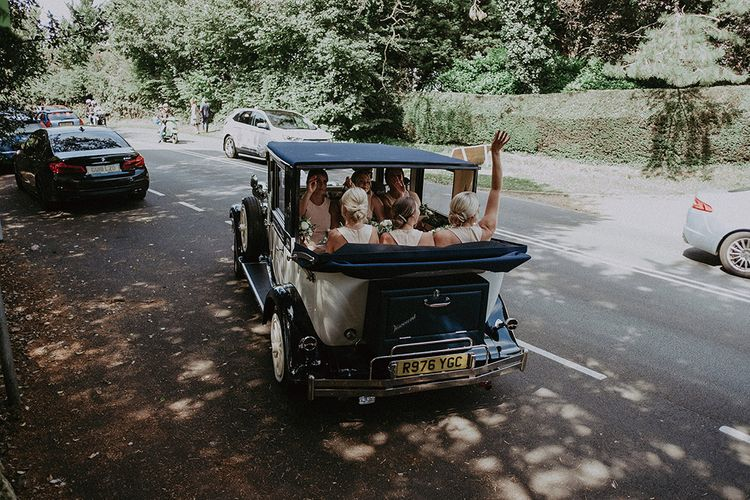 Bridal Party Sitting in Vintage Wedding Car