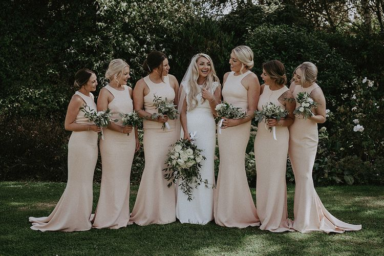 Bridal Party with Bridesmaids in Blush Pink Dresses and Bride in St Patrick Wedding Dress
