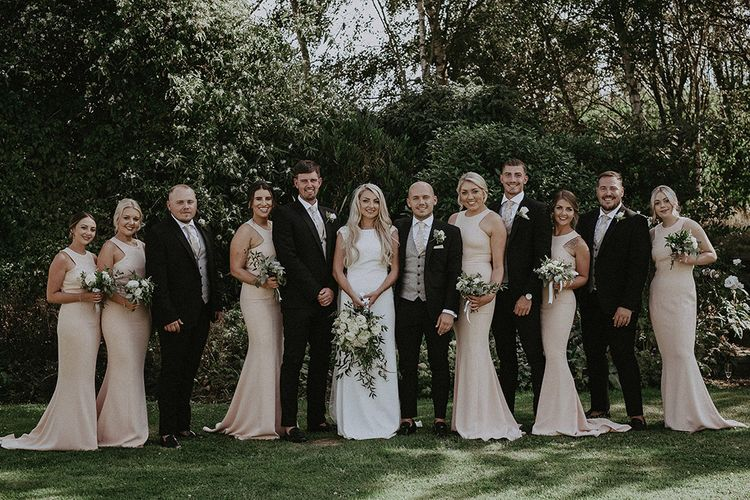 Wedding Party with Bridesmaids in Blush Pink Dresses, Bride in St Patrick Wedding Dress and Groomsmen in Dark Suits