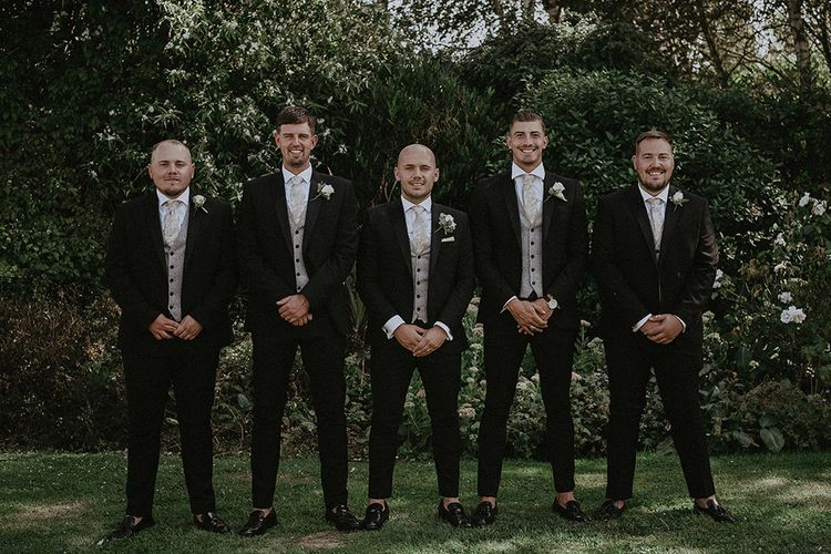 Groomsmen in Dark Suits and Loafers