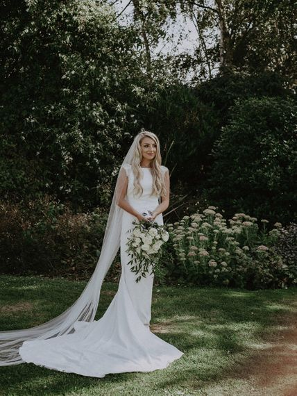 Beautiful Bride in Fitted St Patrick Wedding Dress with Cathedral Veil and White and Green Bouquet