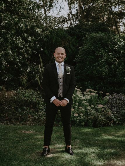 Groom in Dark Suit with Printed Waistcoat and Loafers
