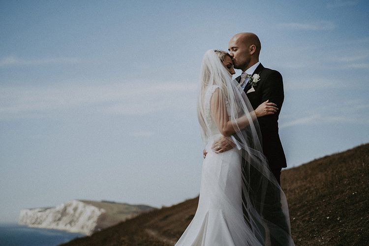 Isle of Wight Coastal Portrait of Bride in St Patrick Wedding Dress and Wedding Veil with Groom in Dark Suit
