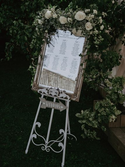 Ornate Mirror Table Plan with White and Green Wedding Flower Decor
