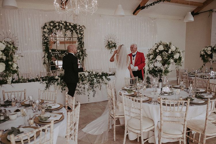 Bride and Groom Standing in Marquee Reception with Toast Master