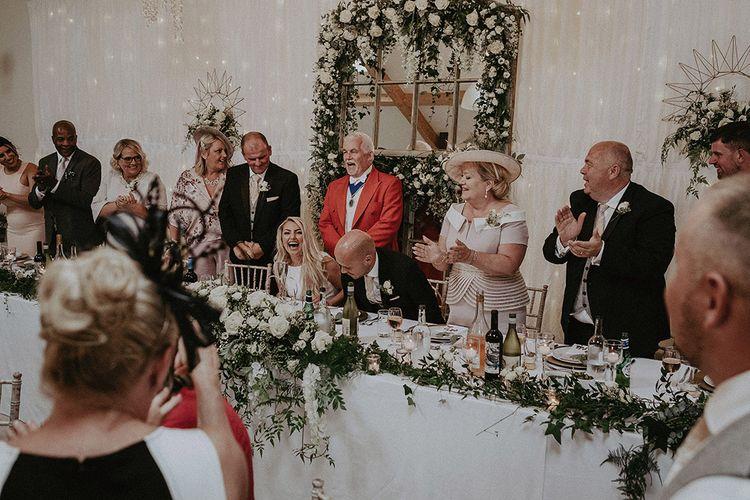 Master of Ceremonies Announcing Bride and Groom in Wedding Reception