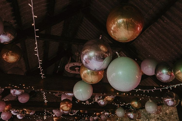 Fairy Lights and Metallic Balls Decorating The Ceiling