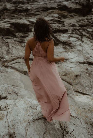 Bride-to-be in a pink maxi dress for engagement session