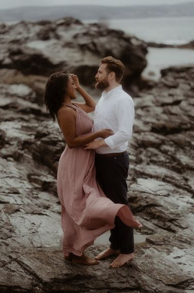 Bride-to-be in a pink dress for a coastal engagement session