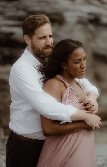 Groom-to-be in white shirt embracing his bride-to-be