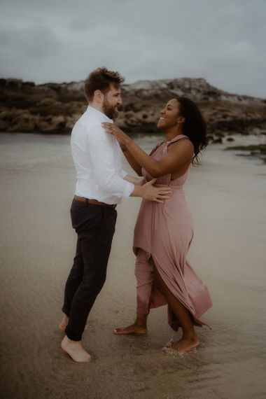 Emotive engagement session on the beach