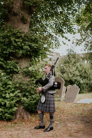 Bagpipes play for Scottish wedding in Sussex