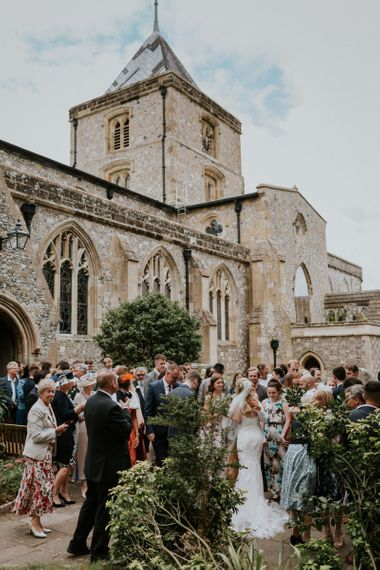 Wedding guests outside church