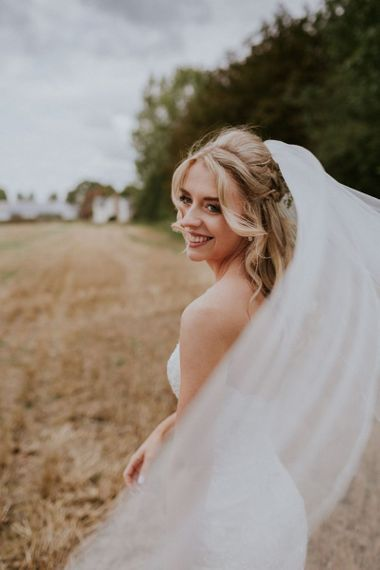 Bride with hair half up half down style and veil