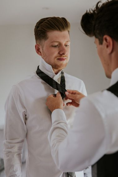 Groom preparations for Sussex wedding