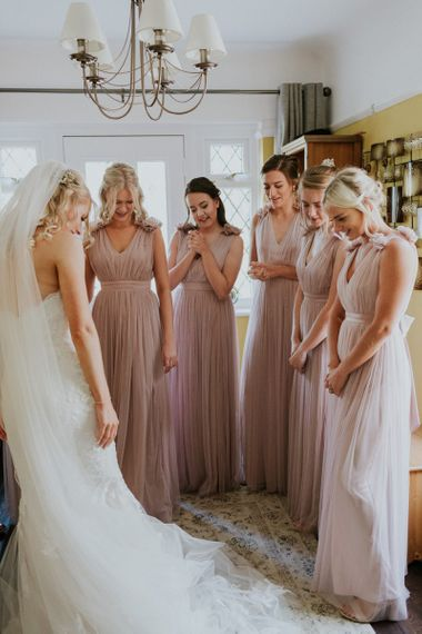 Pink bridesmaid dresses with Enzoani wedding dress