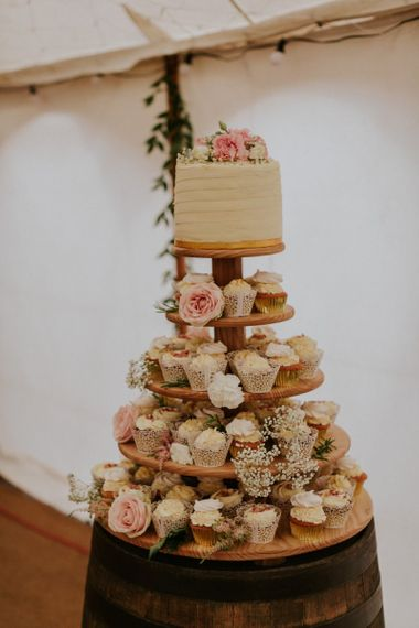 Wedding cake and cupcakes with flower decoration