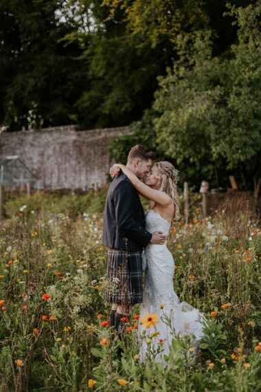 Bride in strapless Enzoani wedding dress and groom in kilt