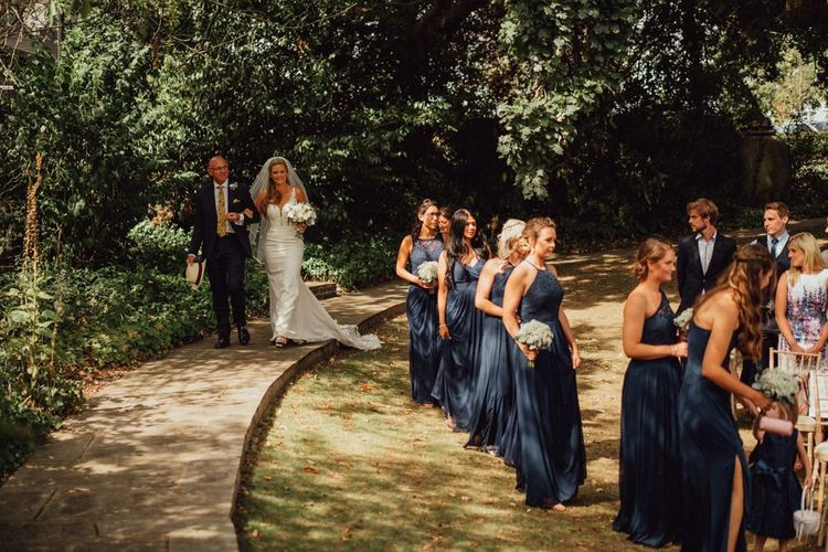 Navy bridesmaid dresses and lace bride dress for Micklefield Hall wedding