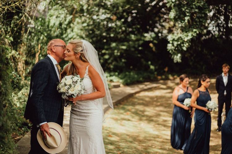 Bride kisses father at Altar before greeting wife-to-be