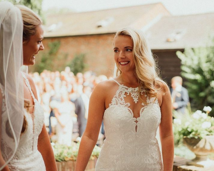 Bride in lace halter neck wedding dress