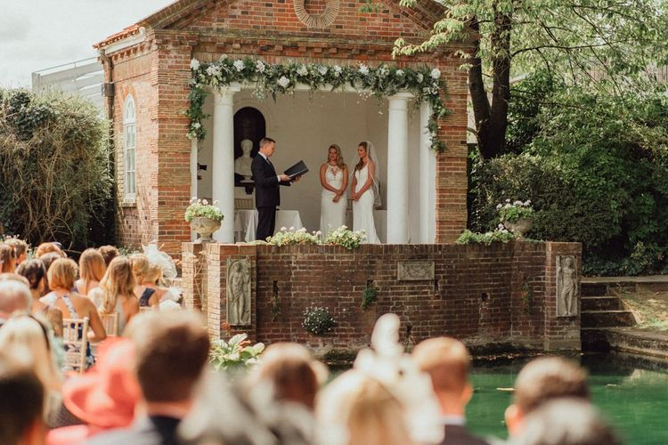 Beautiful outdoor wedding ceremony next to pond at Micklefield Hall wedding