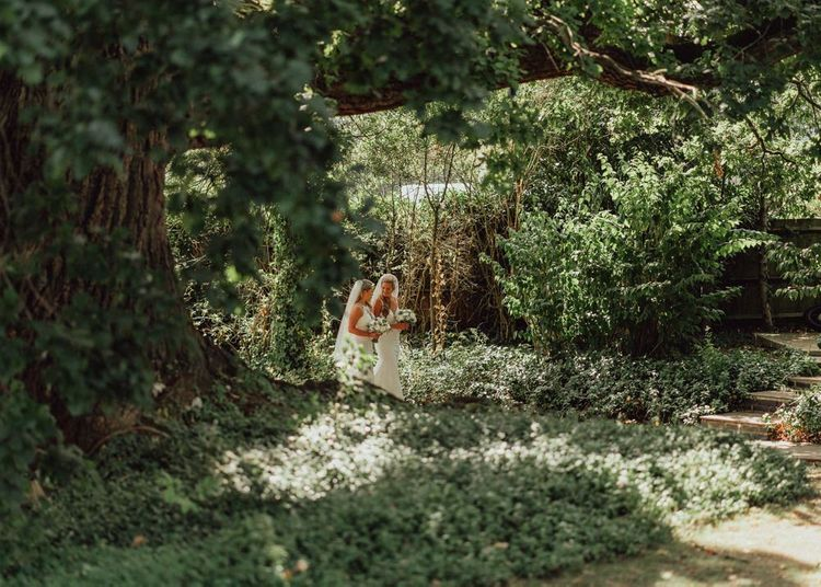 Brides take a stroll through Micklefield Hall wedding venue grounds