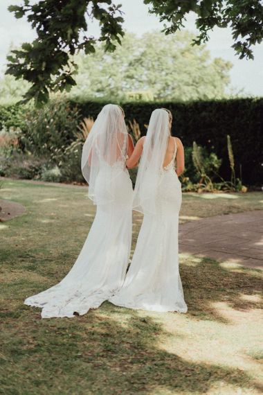Low back lace wedding dress with veil for same-sex wedding