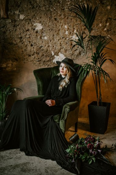 Bride in Black Wedding Dress & Hat with Leather Jacket | Forest Green and Black Dark Decadence Wedding Inspiration in a Rustic Barn Planned & Styled by Knots & Kisses with Images by Daze of Glory Photography