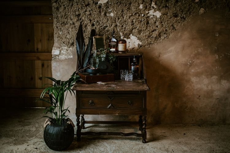 Vintage Writing Desk Cigar & Whiskey Station | Forest Green and Black Dark Decadence Wedding Inspiration in a Rustic Barn Planned & Styled by Knots & Kisses with Images by Daze of Glory Photography