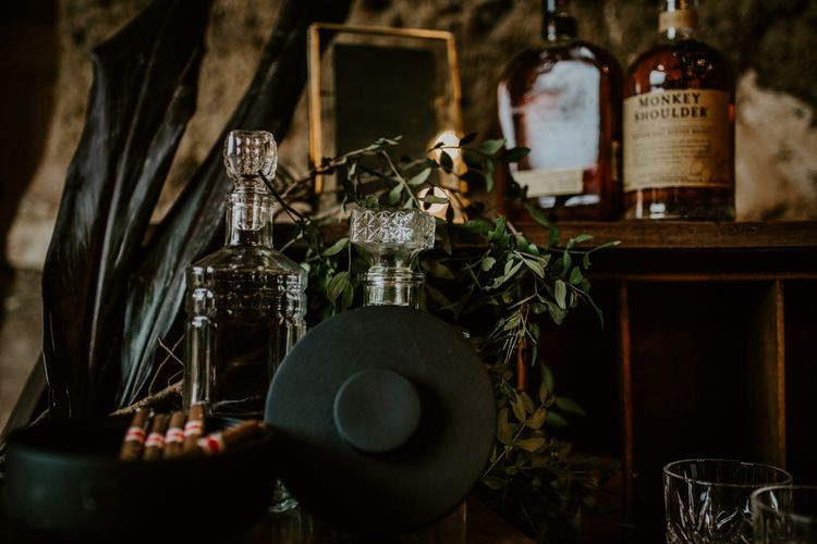 Cut Glass Decanters Whiskey Station | Forest Green and Black Dark Decadence Wedding Inspiration in a Rustic Barn Planned & Styled by Knots & Kisses with Images by Daze of Glory Photography