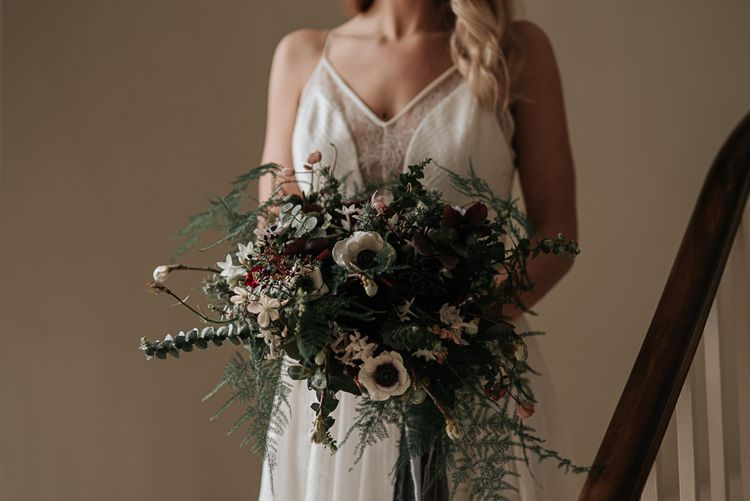 Bride in Raimon Bundo Gown | Anemone Bouquet | Dark & Dreamy Celestial Wedding Inspiration by Save the Date Event Stylist at East Bridgford Hill, Nottingham | Pear & Bear Photography