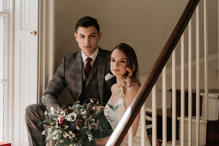 Bride in Raimon Bundo Gown | Groom in Check Slaters Suit | Anemone Bouquet | Dark & Dreamy Celestial Wedding Inspiration by Save the Date Event Stylist at East Bridgford Hill, Nottingham | Pear & Bear Photography