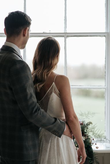 Bride in Raimon Bundo Gown | Groom in Check Slaters Suit | Dark & Dreamy Celestial Wedding Inspiration by Save the Date Event Stylist at East Bridgford Hill, Nottingham | Pear & Bear Photography