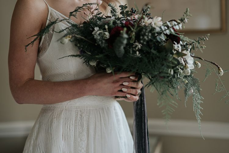 Bride in Raimon Bundo Gown | Oversized Bridal Bouquet with Anemones | Dark & Dreamy Celestial Wedding Inspiration by Save the Date Event Stylist at East Bridgford Hill, Nottingham | Pear & Bear Photography