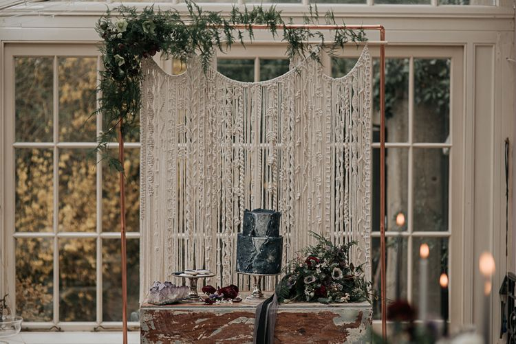 Macrame Hanging Wall Decor | Cake Table | Dark & Dreamy Celestial Wedding Inspiration by Save the Date Event Stylist at East Bridgford Hill, Nottingham | Pear & Bear Photography