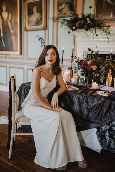 Bride in River Elliot Bridal Gown   Tablescape with Candlesticks    Dark Opulence Inspiration at Anstey Hall, Cambridgeshire Styled by Mia Sylvia   Camilla Andrea Photography